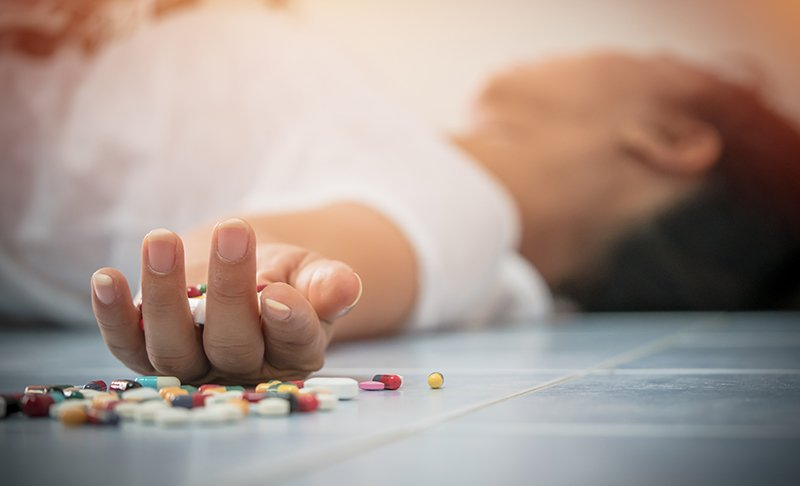 Drug Addiction - A man is passed out after doing drugs. His drug addiction has reached a dangerous level and he needs help.