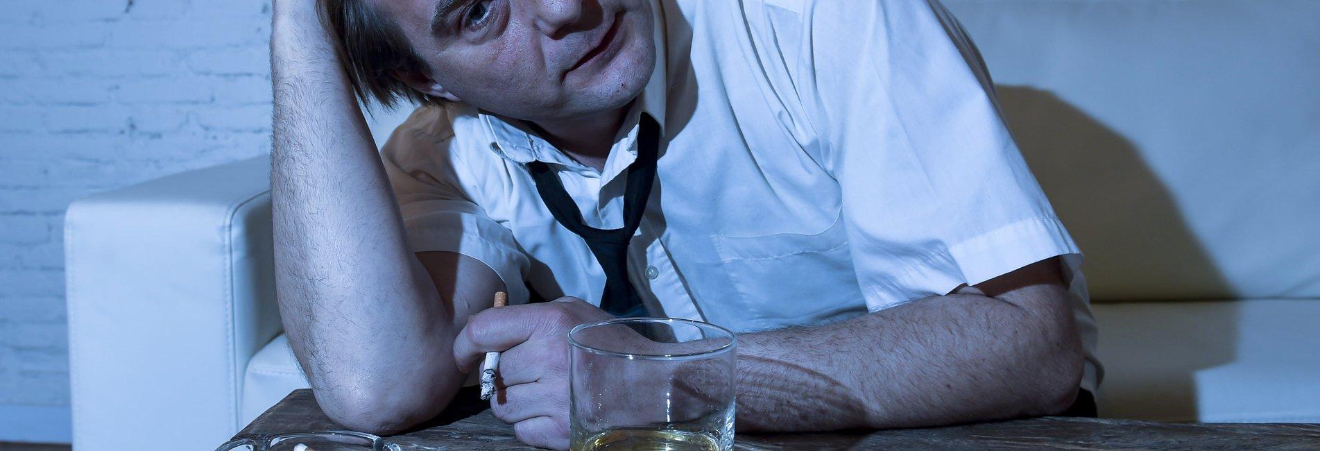 Biochemistry of Addiction Resurgence – A man fighting addiction smokes and drinks.