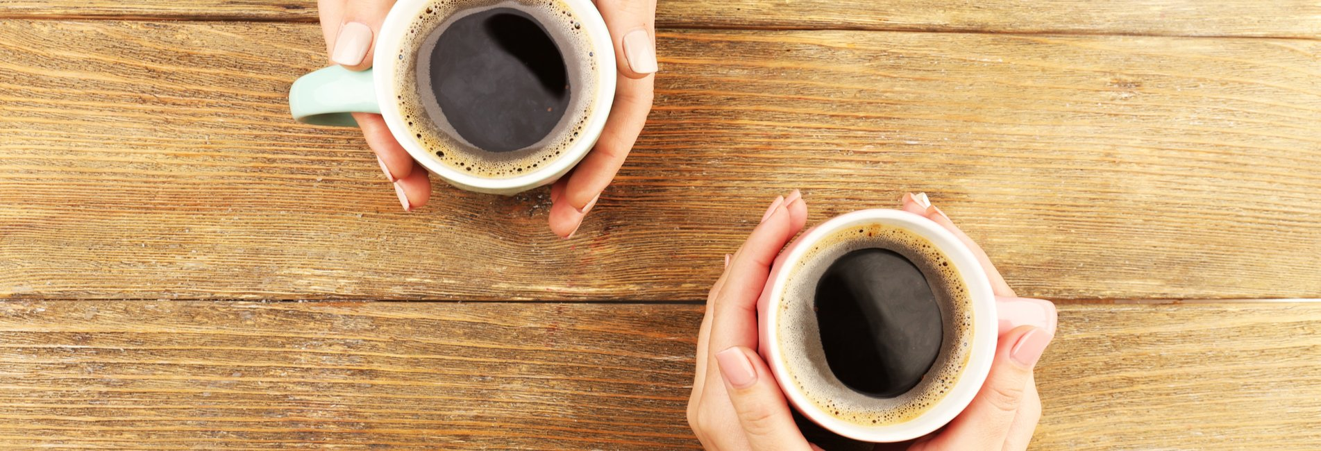 Coffee Can Rewire Your Brain for Addiction Resurgence – Two cups of coffee in hands are pictured. There is a relationship between coffee and addiction, so if you're struggling with any kind of addiction, a treatment center can help.