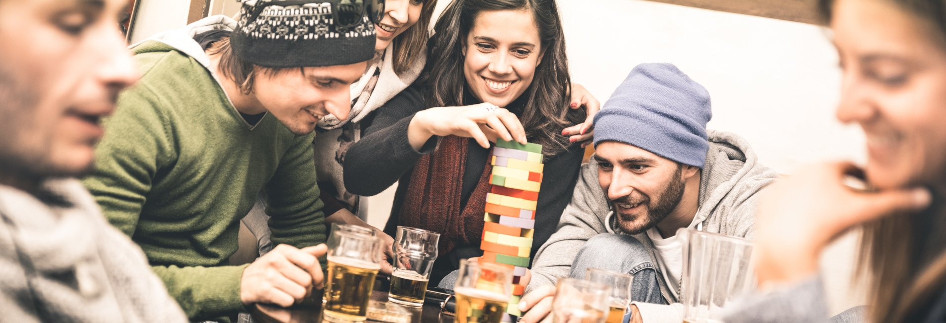 Drinking Drug Abuse and Greek Life Resurgence – College students drink and play a game. Substance abuse is a common problem for many who become involved in Greek life on college campuses.