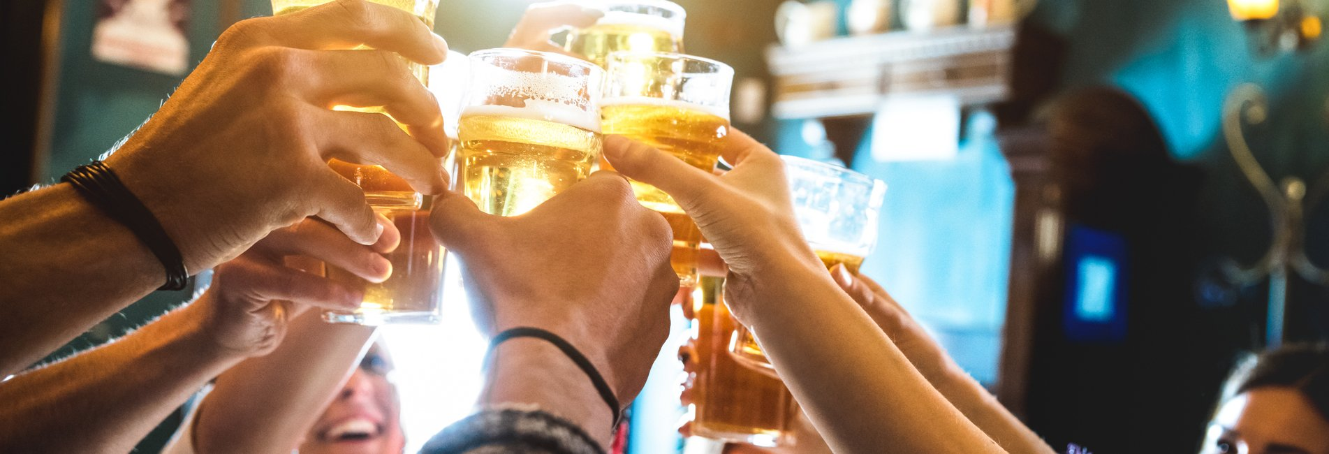What is Binge Drinking Resurgence – Binge drinking college students toast at a local bar.