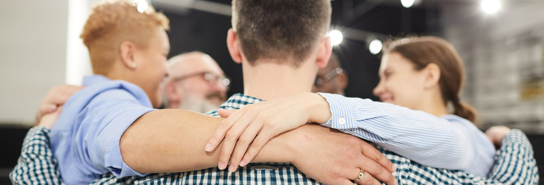 12-Step Programs Do Not Work, Or Do They? - Resurgence - A group of individuals meets for their 12-step programs after inpatient treatment as a form of addiction aftercare to help maintain their sobriety.