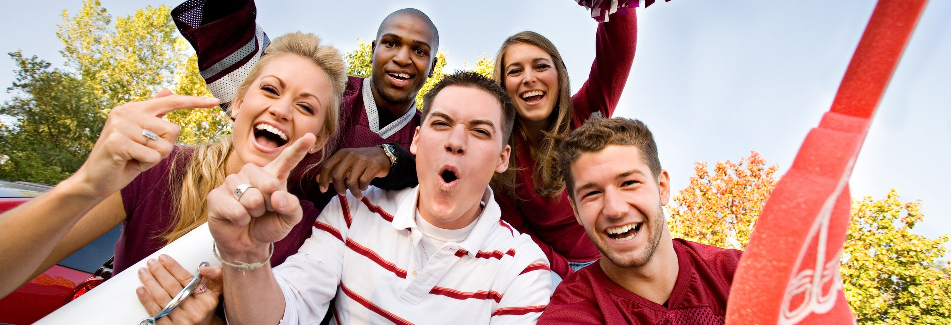 Living A Sober College Life: What Does This Mean? Resurgence - A group of college students is enjoying a home football game while living a sober college life to avoid substance abuse issues and remain in recovery.