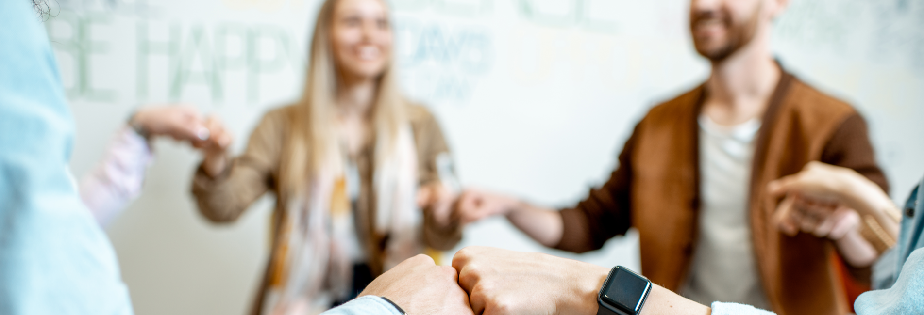 12 Step Addiction Treatment in California - Resurgence - A group of individuals attending a 12 Step addiction treatment in California meeting is holding hands to offer support to one another during their recovery journeys.